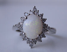 9 ct Y/GOLD SOLITARE OPAL AND DIAMOND  (GH-SI) CEN SIZE USED