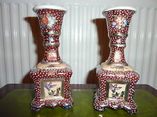 A PAIR OF DECORATIVE CHINESE HAND MADE AND PAINTED CHINA CANDLESTICKS