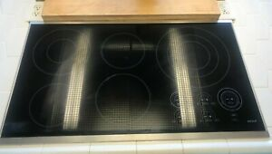 """WOLF MODEL CT36E/S 36"""" ELECTRIC TOUCH CONTROL COOKTOP BLACK  SILVER FRAME"""