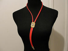 red bolo tie with horseback rider holding hat cowboy