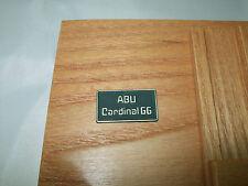 ABU CARDINAL 66 SIDE PLATE BADGE