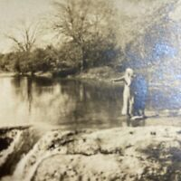 Antique Postcard Couple Standing by a Cold River RPPC Real Photo VELOX 1907-1909