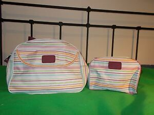 Set of two matching Yves Rocher toilette travel bags, striped wipe clean surface