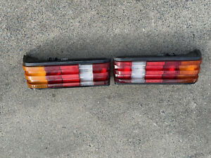 84-93 Mercedes Benz W201 pair of OEM taillights 190E 190D very good!