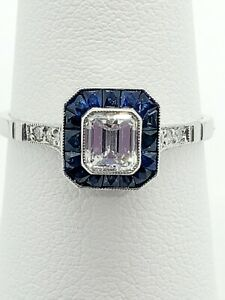 Emerald-cut Diamond and Blue Sapphire Halo Ring in Platinum - size 7.5