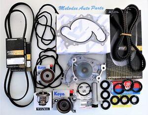 OEM Aisin W/P & Timing Belt kit W/ Serpentine Belt  For Toyota / Lexus  1MZFE