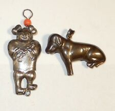 PAIR OF HAND MADE STERLING SILVER CHINESE MAN AND DOG PENDANTS