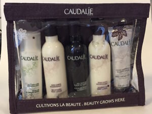 CAUDALIE PARIS 5 PIECE BODY SKIN CARE GIFT SET IN ZIPPERED CLEAR POUCH- new