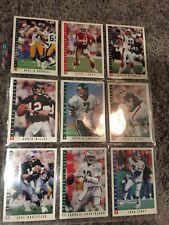 Fourteen 1993 score quarterback football cards