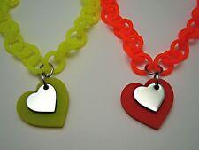 Modeschmuck-Halsketten aus Kunststoff mit Herz-Schliffform
