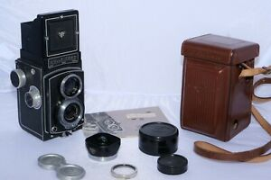Vintage Rolliecord IV Twin Lens Reflex 6x6cm film camera with cap, case, hood.