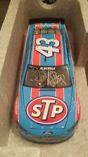 2016 Aric Almirola #43 Dual Autographed by Petty/Inman STP Darlington Throwback
