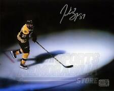 Patrice Bergeron Boston Bruins Signed Autographed Spotlight Entrance 8x10