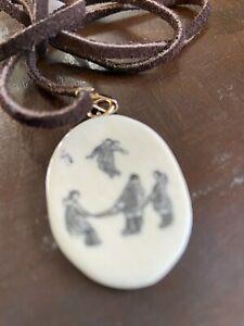 Alaskan Scrimshaw pendant on leather necklace