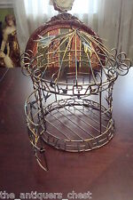 Wired Bird Cage decorated with leaves[*]