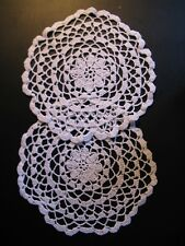 Two old vintage round doilies...completely hooked with a flower in the middle...