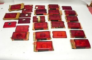 1942-43-44-45-46-47  TAILLIGHT LENSES LOT 26 MIX OF NEW AND USED NICE GM#5933111