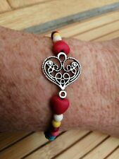Multicoloured dyed turquoise beads with tibetan silver heart stretch bracelet