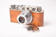 COPY leica with wood coated and Elmar f/3.5 - 50mm lens. Front cap.