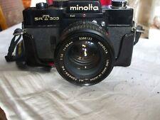 MINOLTA SRT 303 35MM SLR WITH LEATHER CASE & ROKKOR LENS (FULL BLACK MODEL)