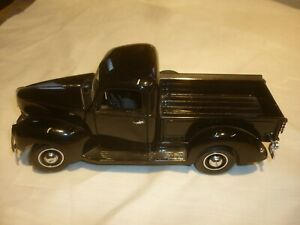 A Franklin mint of a scale model of a 1940 Ford Pick up truck, no box