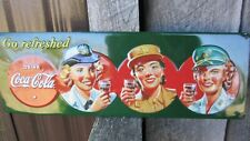 Coca-Cola 3-D Embossed Tin Sign Women of the Military Go Refreshed