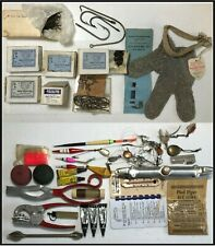 Fishing items bobbers, hooks, fish holder, & lots more.