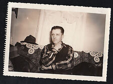 Antique Photograph Man Sitting With Hat on Back of Sofa in Retro Living Room