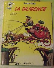Ancienne Bd Lucky Luke 1985 la Diligence western Cowboy Cheval Valise Malle