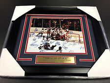 AUTOGRAPHED REPRINT COPY OF 1980 TEAM USA MIRACLE ON ICE FRAMED 8X10 PHOTO