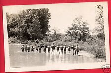 RPPC  15 BOYS STANDING KNEE DEEP IN WATER WITH HANDS ON EACH OTHER'S BACKS RPPC