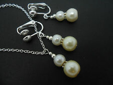 AN IVORY PEARL   NECKLACE AND CLIP ON  EARRING SET. NEW.
