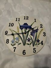 Floral ceramic wall clock. Battery operated.