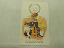 VINTAGE KIDS PLAYING A MERRY CHRISTMAS POSTCARD  MAILED 1926