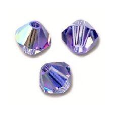 20 Perles Toupies 4mm en cristal Swarovski - TANZANITE AB Xilion