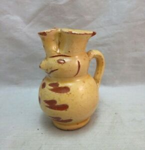 Antique Yellow ware mini creamer with man's face