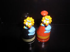 The SimpsonsLisa Simpson 2 Pvc red base and black base Figurines