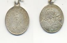 Medalla antigua. San Luis de Gonzaga. Plateada. Tamaño 25x19 mm. 2,62 Gr.