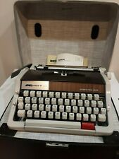 VINTAGE KMART BROTHER 200 PORTABLE TYPEWRITER W/ORIGINAL CASE WITH INSTRUCTIONS