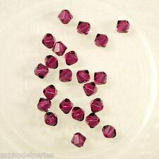 50 perles  toupies en cristal de Swarovski  5328 Fuchsia 4 mm