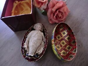 antique German miniature doll in Easter egg
