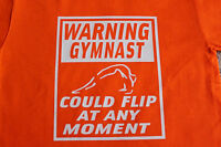 "Gymnastics ""Warning gymnast could flip""  t-shirt bright Yellow & Orange"