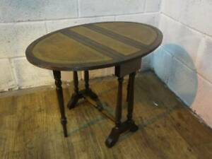 MAHOGANY WITH LEATHER INLAY DROP LEAF COFFEE / OCCASIONAL TABLE.