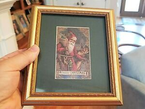 Framed Art Print: A HAPPY CHRISTMAS Old World Style SANTA CLAUSE with Sack Deer