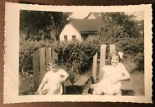 Photo 2 young little girls posing in Adirondack chairs happy spunky kids