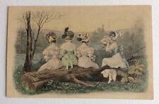 CPA. Quatre Jeunes Filles assises sur un tronc d'arbre. Eau. Rivière. VIENNE.