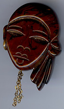VINTAGE CARVED MARBLED BAKELITE LADY WITH EARRING FACE PIN