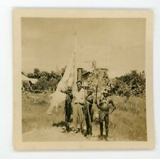 Aboriginal or tribe  members  in traditional costume with weapons Vintage photo