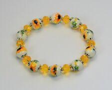 Sunflower porcelain bead & golden yellow glass crystal elasticated bracelet