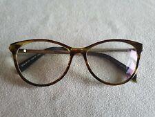Kylie Minogue 05 brown tortoiseshell / gold glasses frames.